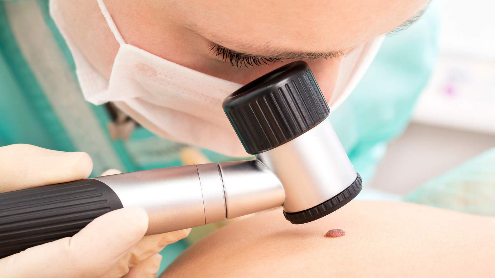 Dermatologist examining a patient