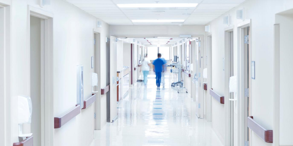 Doctors walking down a hospital corridor.