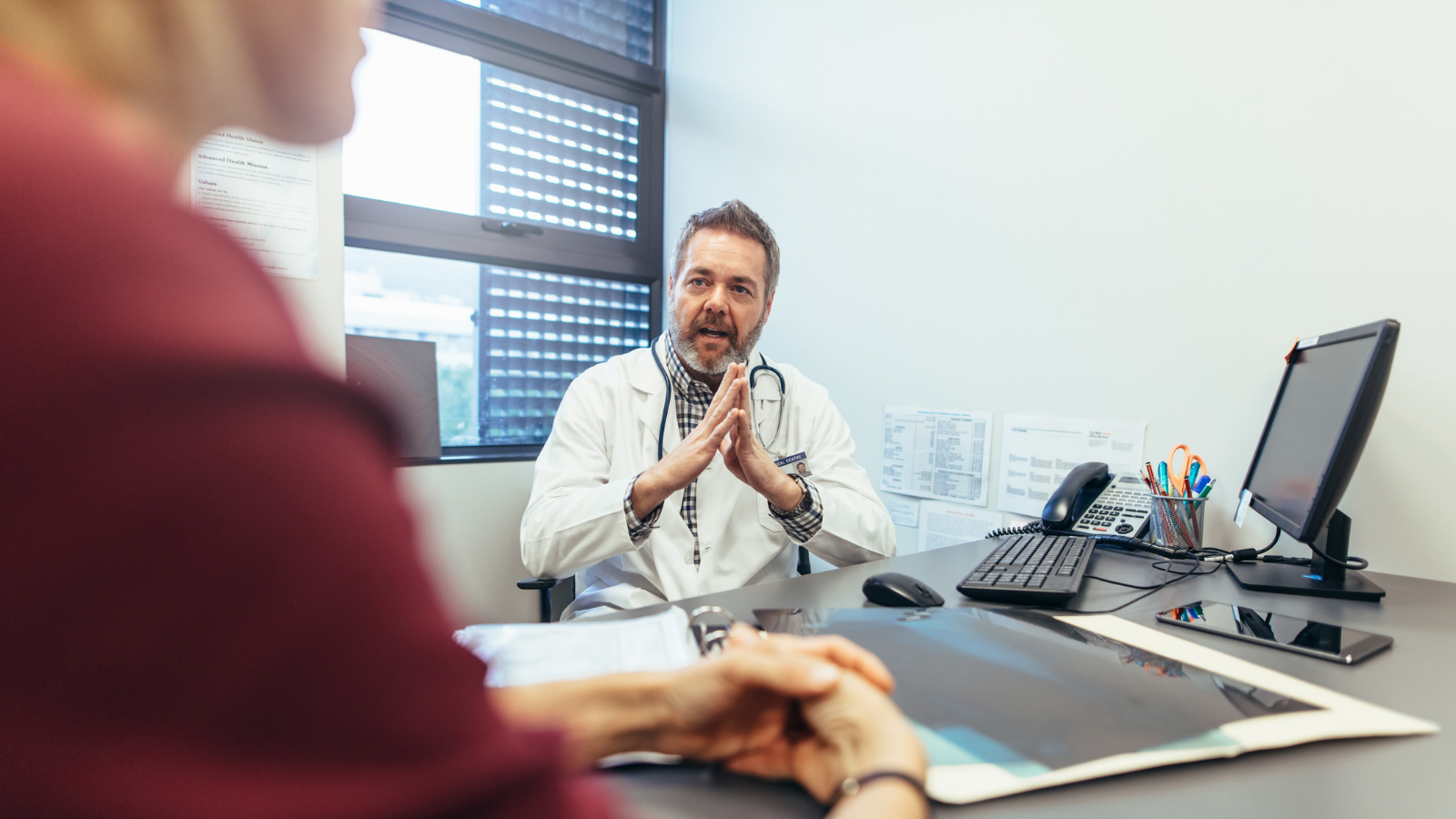 Clinician counseling a patient