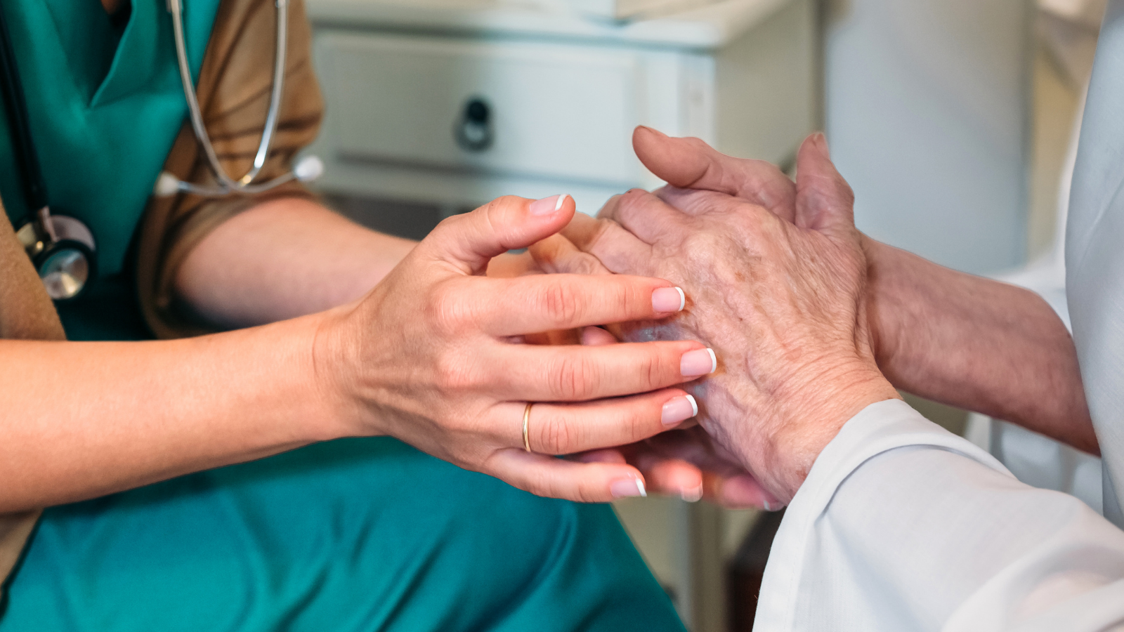 A healthcare provider and patient in a hospice setting.