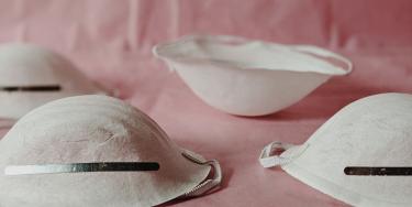 Face masks on pink background