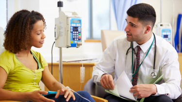 Photo of patient speaking with physician