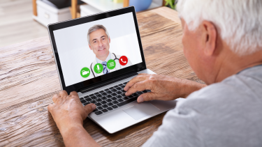 Patient and doctor conducting a telehealth video consultation
